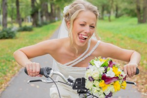 Bride on a bicycle being flirty